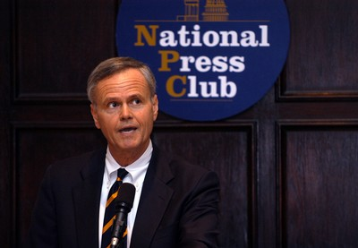 Dean Anderson presenting the Bart Richards Award at the National Press Club
