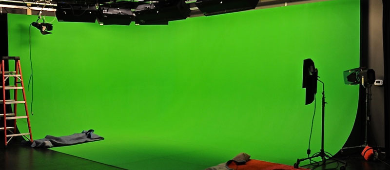 Production space with a green screen setup.