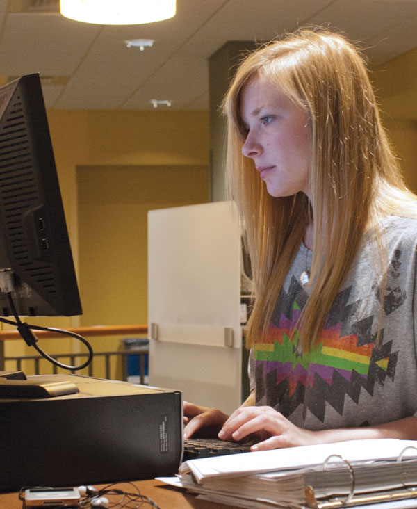 A student working on a Comm research project.