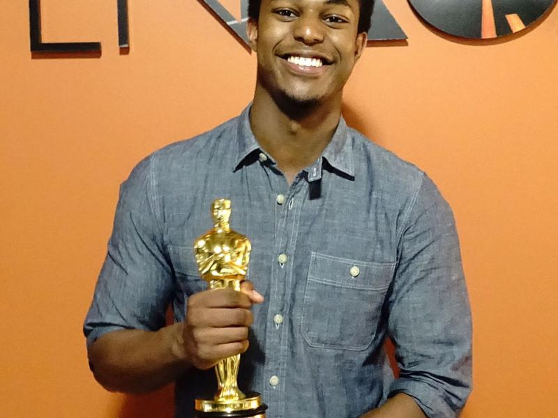 "Penn State Hollywood Program student Carl LaGuerre holds the Oscar for ""Spotlight,"" winner of Best Picture. LaGuerre is an intern at Open Road Films. Penn State alumnus Tom Ortenberg of Open Road was an executive producer on the award-winning and critically acclaimed movie."