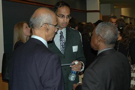 Assistant Dean Joseph Selden (right) talks with Murali (center) and Kodumudi Balaji.