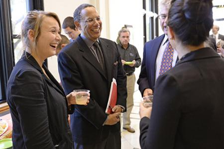 Baquet talks with students during a reception before his presentation.