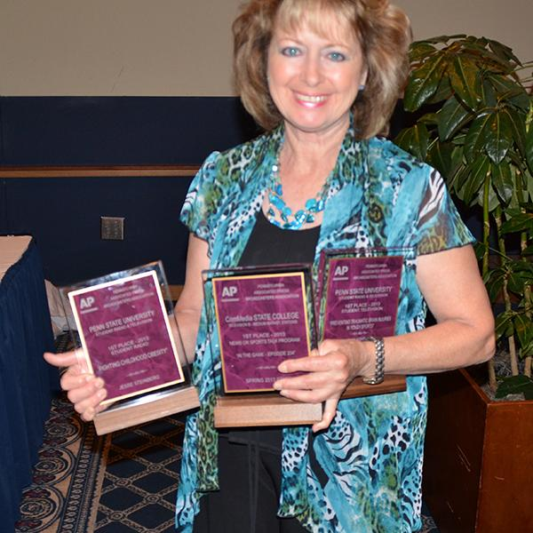 Senior lecturer Marea Mannion collected the awards earned by students in the contest.