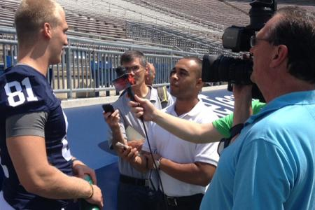 Jake Somerville asks a question of tight end Adam Breneman during a group interview.