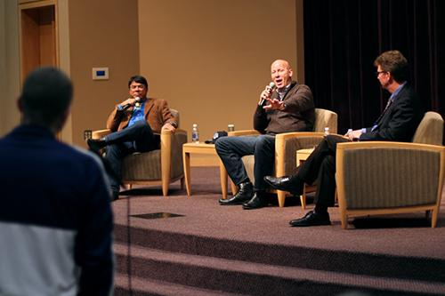 Mike Wise (center) of The Washington Post responds to a question while on stage with Ray Halbritter (left) and John Affleck.