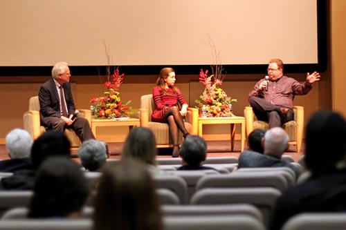 Prof. Patrick Parsons (left) and Brittany Foster listen as Eric Arneson makes a point. (Photo by Jeanine Wells)