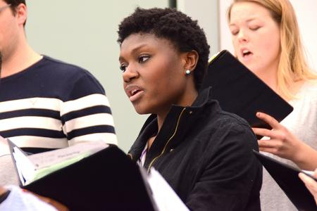 Choir member, Maya Kouassi, 21, rehearses a piece from Winterfest 2014. (Photo by Alexandra Zortman)