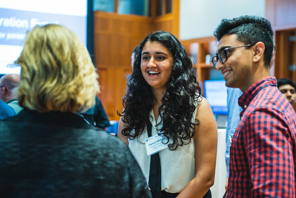 Students in conversation at a recruiting event