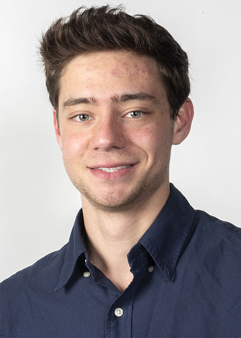 Studio headshot for Leo Massey