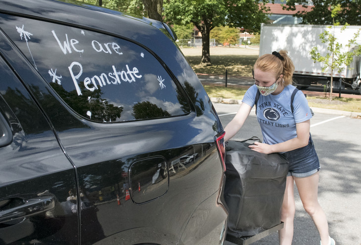Student unloading her car