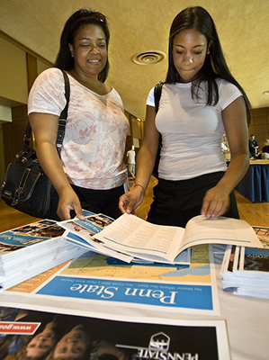 prospective student and mother reviewing information.