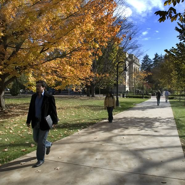 Students walk along the Old Main mall in the fall.