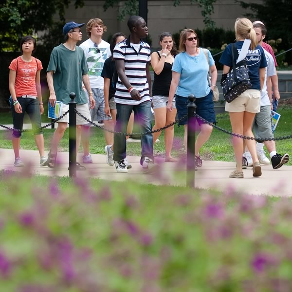 Prospective students and their families walk with a Lion Ambassador on a campus tour.