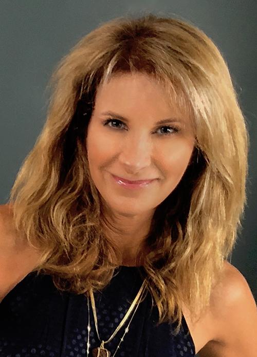 Headshot of alumni member Kathy Heasley