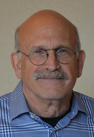 Headshot of alumni member Mike Marcus
